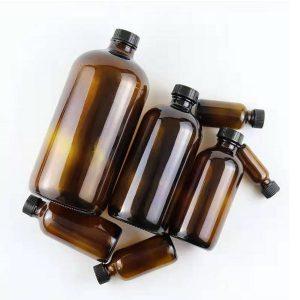 Amber Boston round glass bottle
