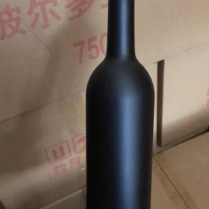 Black wine glass bottle with label