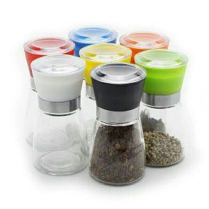 Seasonal glass jar with plastic colorful grinder