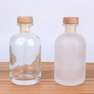 Clear frosted round glass bottle with cork for vodka coffee beverage