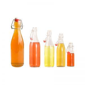Round glass water bottle juice bottle swing top cap